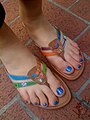 Woman wearing leather flip flops.jpg
