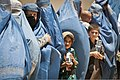 Women and children who were treated at the Egyptian Field Hospital wait in line to exit Bagram Airfield in Bagram, Parwan province, Afghanistan, June 3, 2012 120603-A-ZU930-011.jpg