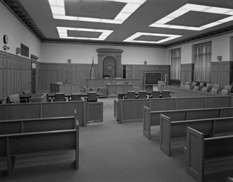 Bar (law) - In this courtroom in Worcester, Massachusetts (United States), the bar is represented by a physical barrier (with swinging gate doors), separating the benches reserved for spectators from the judge's bench and lawyers' tables