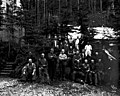 Work crew in front of two log buildings, Snohomish County, ca 1923 (PICKETT 359).jpeg