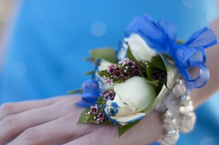 small bouquet of flowers worn on a woman