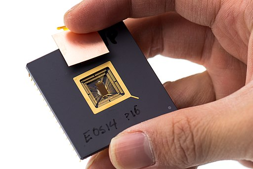 Yunsup Lee holding RISC V prototype chip