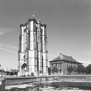 "Sint-Lievensmonstertoren - 1975 photograph of the current tower, with the later ""Nieuwe Kerk"" (""New Church"") to the right"