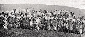 Zulu people - Zulu warriors, late nineteenth century (Europeans in background)