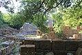 البناء الأقدم ذو اللون الازرق والكنائس التي تعود للعصور الوسطي بالحجر الأسمر.jpg