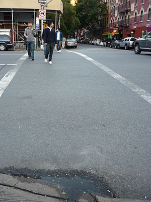 Big Apple Pothole and Sidewalk Protection Committee - A cracked New York City sidewalk
