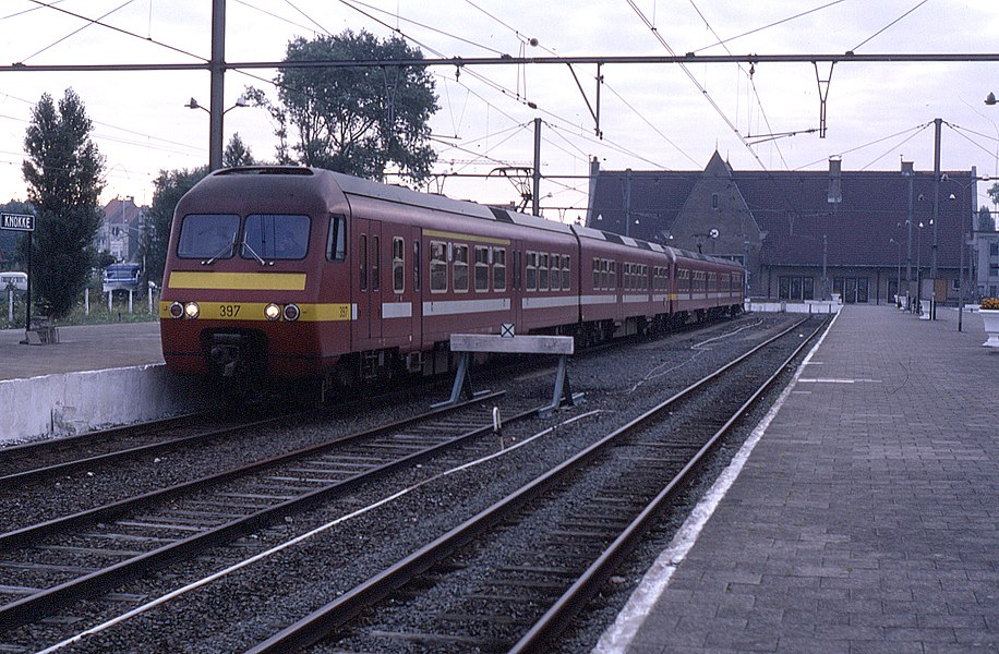 "2-car class AM83 ""Break"" units operated by the Belgian Railways. At the time of this visit in September 1987 they worked InterCity services from Knokke as seen here. Normal service pattern was to join up with a portion at Brugge originating from Blankenberge. The sets would continue through Brussels splitting at Landen - one part for Genk and the other for Maastricht.   Seen here on 5 September 1987- 397 nearest the camera with 385 behind."