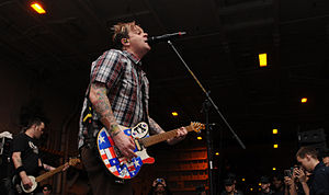 120302-N-KQ416-101 — lead vocalist and rhythm guitarist for the Grammy Award-nominated punk rock band Bowling for Soup, performs for Sailors.jpg