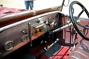 Morris Oxford bullnose - L to R, the distant handbrake, the interfering change-speed lever and the under-wheel spark control. Before the steering column is a smokers' companion and the dash displays a fuel gauge