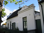 These properties were granted in 1750 to the landdrost and Heemrade, and to Jan Greyling. The complex of buildings is of special architectural interest and forms an essential part of the historic core of Stellenbosch.