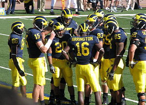 Stephen Schilling - 2007 Michigan Wolverines huddle with Mario Manningham (86), Ryan Mallett (15), Mike Hart (20), Jake Long (77, behind Hart), Adrian Arrington (16), Mike Massey (83), Justin Boren (65), Carson Butler (85), and Schilling (partially in view on right) (52).