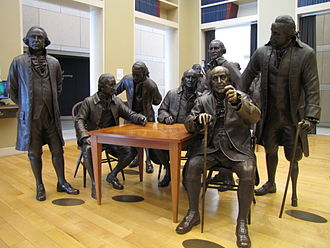Life-size bronze statue of Benjamin Franklin (seated) in the National Constitution Center, Philadelphia 2012-07 ncc 04.JPG