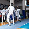 2nd Leonidas Pirgos Fencing Tournament. Flèche and touch for the fencer on the right.jpg