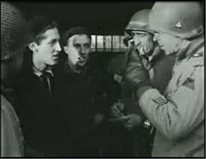 3rd Armored Division (United States) - General Boudinot and 3rd AD Officers question locals after liberation of concentration camp