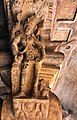 6th century standing woman pillar top looking below in Cave 3, Badami Hindu cave temple Karnataka 6.jpg
