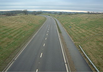 Single carriageway - The A511 in Leicestershire, England: a typical single-carriageway arterial road with one traffic lane for each direction (and, in this case, a two-way pedestrian and cycle way alongside)