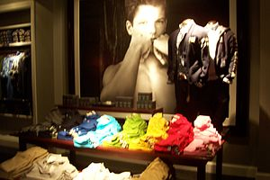 Bruce Weber (photographer) - A Weber photograph in the background on display at an Abercrombie and Fitch store