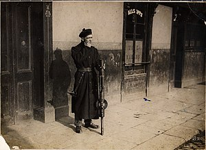 Black and Tans - A Black and Tan in Dublin, smoking and carrying a Lewis gun, February 1921