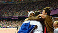 A French athlete celebrates with members of the crowd (9375679833).jpg