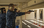 A U.S. Sailor assigned to the amphibious assault ship USS Peleliu (LHA 5) fires at a target during a pistol qualification at Naval Air Station North Island, Calif., Oct. 8, 2013 131008-N-YW024-096.jpg