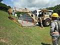 A U.S. Soldier, with the 1224th Engineer Support Company, Guam Army National Guard, watches an excavator dig as part of facility improvements at the Guam Veterans Cemetery in Guam Aug. 6, 2012 120806-A-WW847-244.jpg