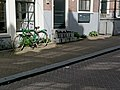 A bicycle, parked in the sun in Amsterdam -City, spring of 2013.jpg