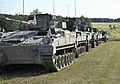 A line of Warrior vehicles wait for a call to action on Salisbury Plain during Exercise Lion Strike. MOD 45157699.jpg