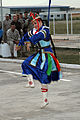A member of the Mongolian Military Song and Dance Academic Ensemble performs a traditional Mongolian dance during a Mongolian culture event as part of exercise Khaan Quest 2013 at the Five Hills Training Area 130804-M-DR618-044.jpg