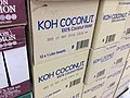 A pile of boxes containing KOH coconut.jpg