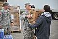A soldier with the New York Army National Guard hands a box of meals to a resident at a distribution point in Long Beach, N.Y., on Nov 121102-F-SV144-019.jpg