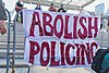 Abolish Policing Sign - Black Lives Matter - Sit In - Occupy Bay Street - College Street - Toronto Police Headquarters - June 19, 2020 - Creative Commons (50026416886).jpg