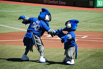 Ace and Junior exchange greetings before the game. Ace was the Blue Jays' second mascot, introduced in 2000. Junior is a mascot occasionally seen for Junior Jays day promotions. Ace and Junior exchange greetings before the game (7968713240).jpg