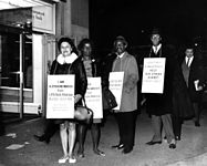 African American and Hispanic American workers on strike against Kellwood, wearing placards that encourage support for better wages (5279068837).jpg