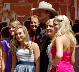 Alan Jackson - Jackson with his family at a ceremony to receive a star on the Hollywood Walk of Fame in April 2010