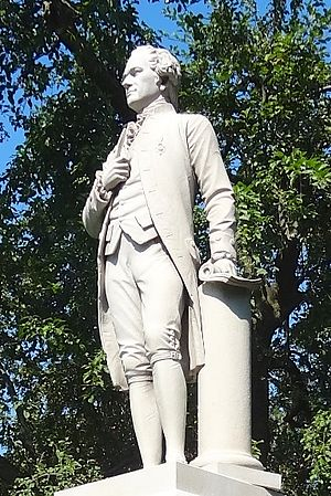 Alexander Hamilton (Conrads) - Statue view showing left hand, document, and column
