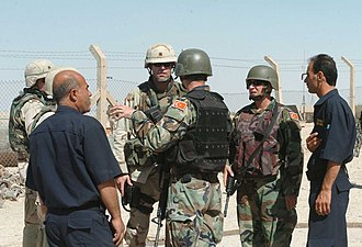 Tal Afar - Soldiers from 416th Civil Affairs Battalion and Turkish military observers speak with local officials are assessing the damages to local infrastructure.
