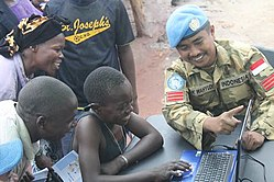 An Indonesian peacekeeper shows Dungu local population that Learning is Fun