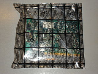 Electrostatic discharge - A network card inside an antistatic bag, a bag made of a partially conductive plastic that acts as a Faraday cage, shielding the card from ESD.