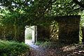 Arch and gate in brick entrance wall to Walled Garden of Goodnestone Park Kent England.jpg
