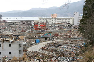 Documentaly - The album was inspired by the events of 2011, including the 2011 Tōhoku earthquake and tsunami (pictured: Minamisanriku, Miyagi in April 2011)