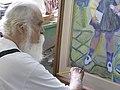 Artista pintando uma obra.jpg