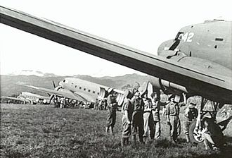 Wau, Papua New Guinea - Unloading WWII transport planes at an advance airfield near Wau in 1943