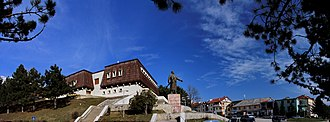 Bajram Curri (town) - Panorama of Bajram Curri monument with the ethnographic museum hiding in the background.