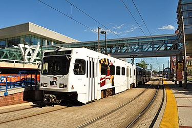 The Baltimore Light RailLink provides service to Baltimore-Washington International Thurgood Marshall Airport and the Baltimore area. Here, a train stops at Convention Center station, just west of the Baltimore Convention Center on Pratt Street. BaltimoreLightRail.JPG