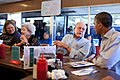 Barack Obama talks with a patron at Reid's House Restaurant in Reidsville, N.C., 2011.jpg