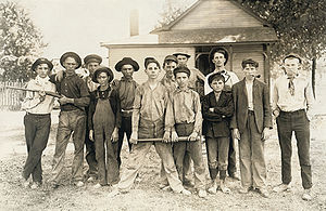 Timeline of young people's rights in the United States - Baseball team composed mostly of child workers from a glass factory.  Photograph by Lewis Hine, 1908.