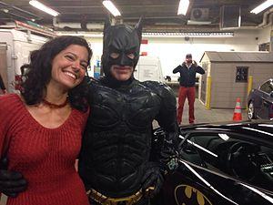 Batkid - The Damsel in distress and Batman actors next to one of two black Lamborghinis which served as the Batmobile