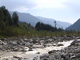 A photograph of beas river and mountains in manali