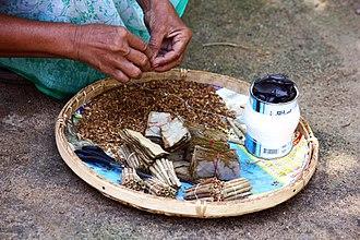 Beedi - Beedi making process, rare handicrafts in Akkaraipattu, Sri Lanka. Bidi leaf (Bauhinia racemosa) and shredded tobacco are prepared and finalize with thread binding.