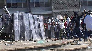 2005 Belize unrest - An encounter between protesters and riot police in Belmopan on January 21, 2005